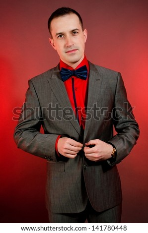 young business man over red background - stock photo