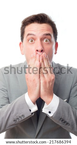 Young business man over white background. Looking scared - stock photo