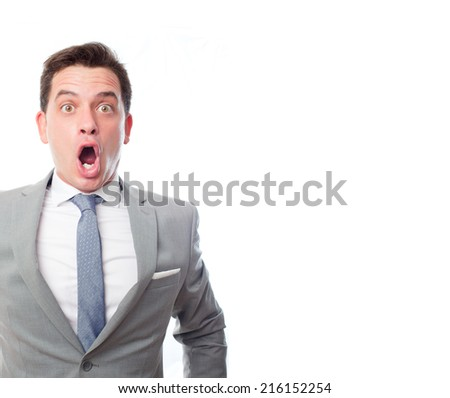 Young business man over white background. Looking surprised - stock photo