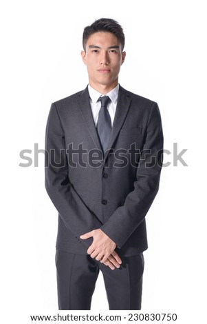 young business man portrait isolated on light background - stock photo