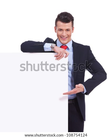 Young business man presenting a  blank board isolated on white background