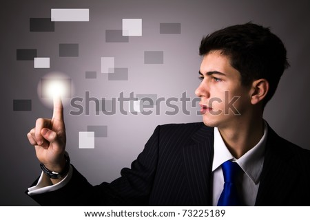 Young business man pressing a digital button