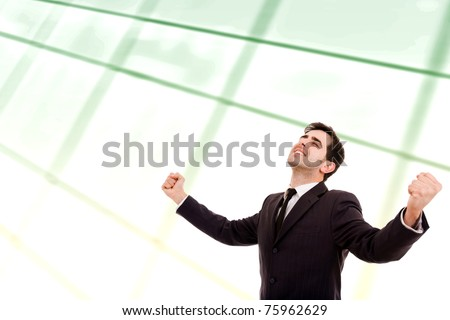 Young business man rejoicing after success at office - stock photo