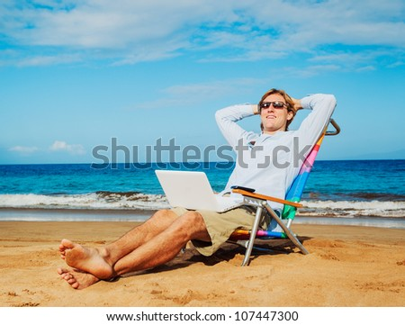 Young Business Man Relaxing on Tropical Beach - stock photo