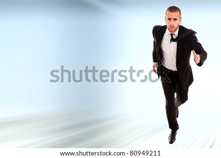 Young business man running - stock photo