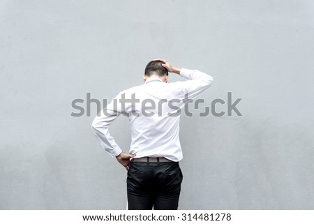 Young business man serious thinking with hand on head - stock photo
