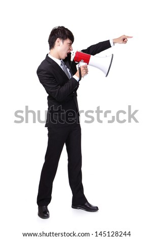 Young business man shouting into a megaphone and finger point to up forward in full length isolated over a white background, asian model - stock photo