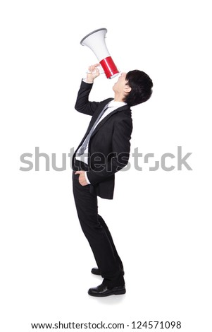 Young business man shouting into a megaphone in full length isolated over a white background, profile side view, asian model - stock photo