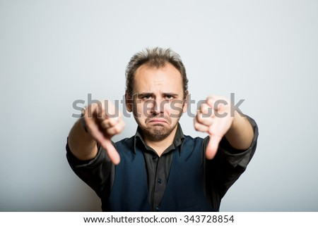 young business man showing thumbs down, manager, office style studio shot isolated on the gray background - stock photo