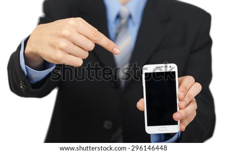 Young business man showing with black display of mobile phone isolated on white background - stock photo