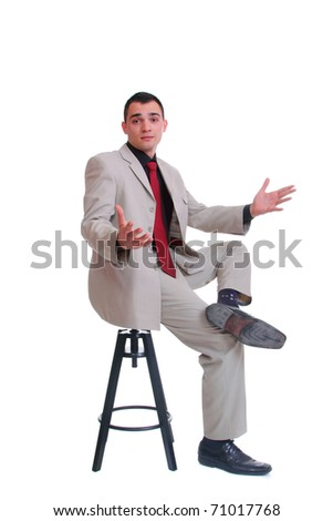 Young business man sits on stool - stock photo