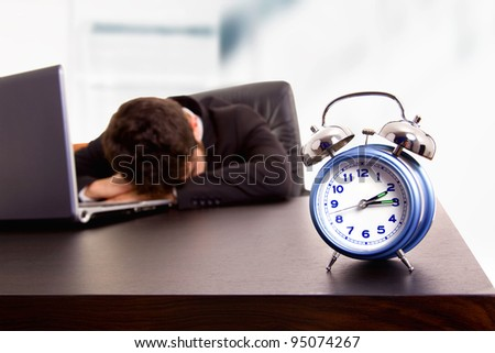 young business man sleeping on the laptop at his office
