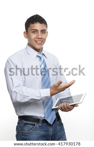 Young business man smiling with computer in hand - stock photo