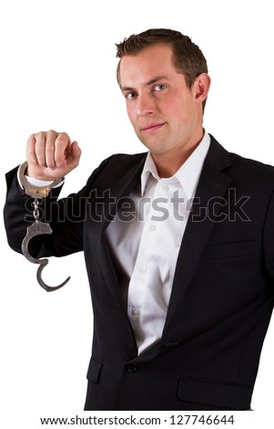 young business man smiling with handcuffs on isolated on a white background