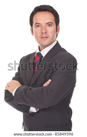 Young business man standing against the wall with crossed arms