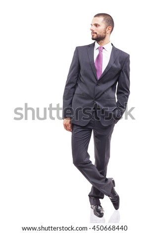 Young business man standing looking at copyspace, isolated on white background - stock photo