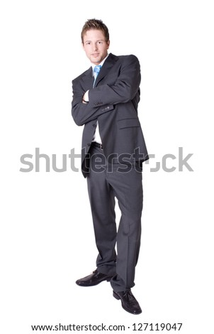 Young business man standing relaxed, leaning backwards.