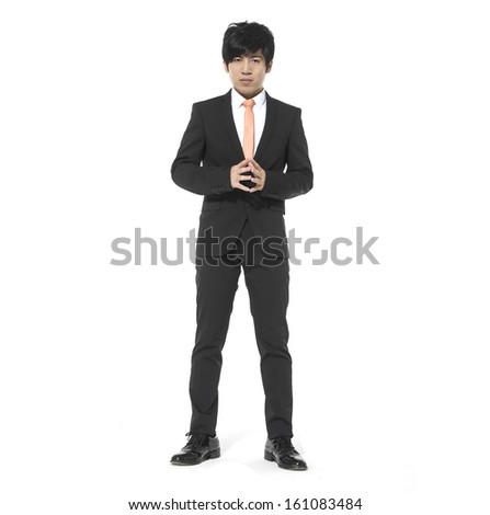 young business man standing with hands on hip against white background