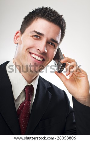 young business man talking on mobile phone - stock photo