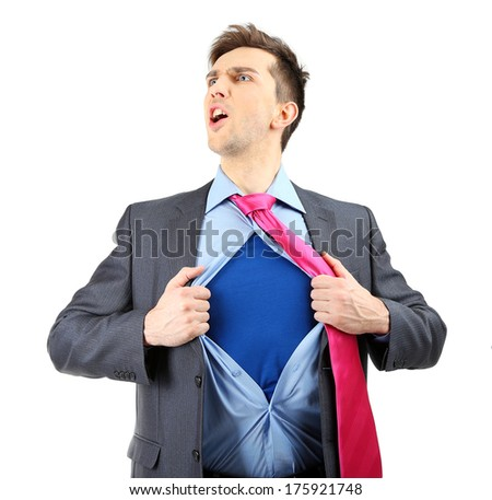 Young business man tearing apart his shirt revealing  superhero suit, isolated on white - stock photo