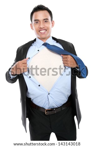 young business man tearing off his shirt on white background - stock photo