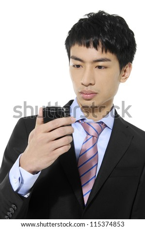 young business man texting on his phone