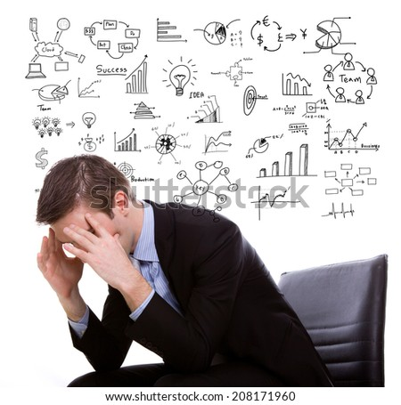Young business man think and planning with business graph - stock photo