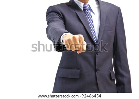 Young business man throwing a punch at you isolated on white - stock photo