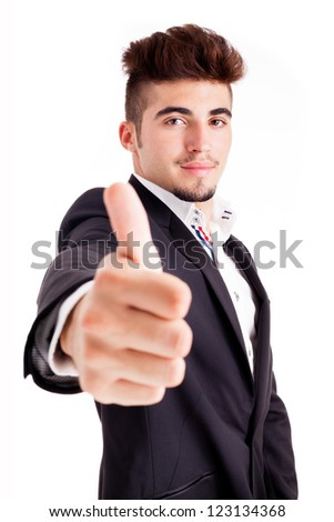 Young business man thumbs up, isolated on white - stock photo
