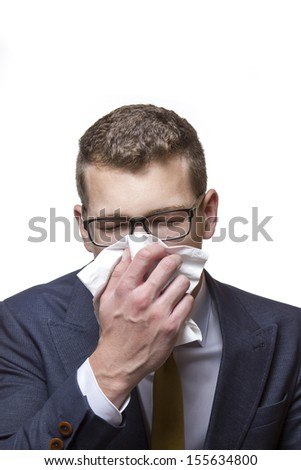 Young business man using a tissue - stock photo