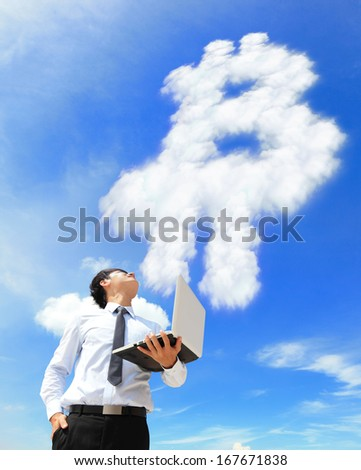 Young business man using laptop and look to  bitcoin cloud, business and bitcoin concept - stock photo