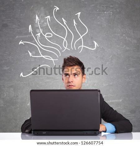 young business man using the laptop computer is thinking at hot to resolve some problems - stock photo