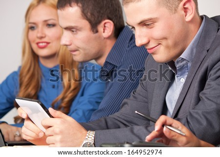 Young business man watching a tablet.
