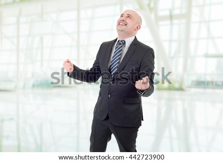 young business man winning, at the office - stock photo