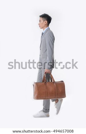 Young business man with a brown leather bag