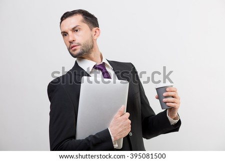 Young business man with a laptop and coffee