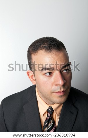Young business man with a serious look on his face. - stock photo