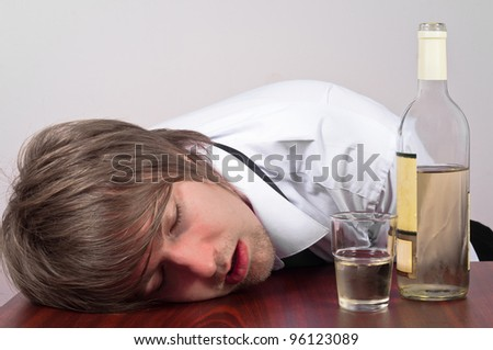 Young business man with alcohol