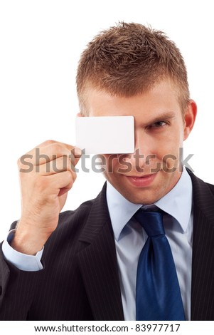 Young business man with blank card in his hand over eye