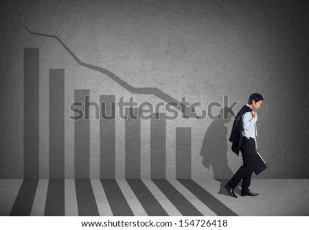 Young business man with failure chart - stock photo