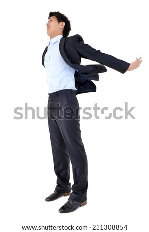 Young business man with his arms in the air - isolated over white background - stock photo