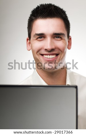 Young business man with laptop close up - stock photo