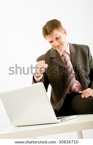 Young business man with laptop computer on white background