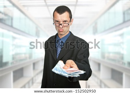 young business man with lots of money - stock photo