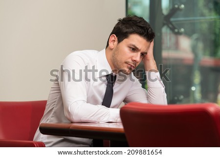 Young Business Man With Problems And Stress In The Office - stock photo