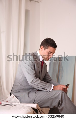 young business man with telephone - stock photo