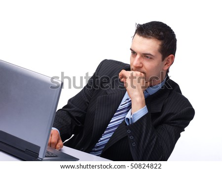 Young business man working on a laptop, isolated against white background.