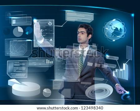 young business man working on futuristic virtual screen - stock photo