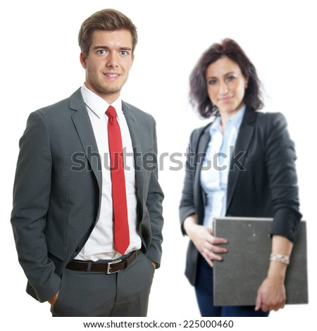 young business manager with secretary holding file folder in the background - stock photo