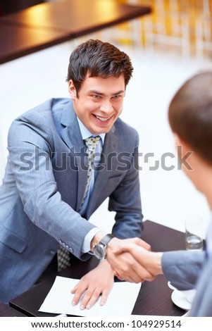 Young business men shake hands - stock photo